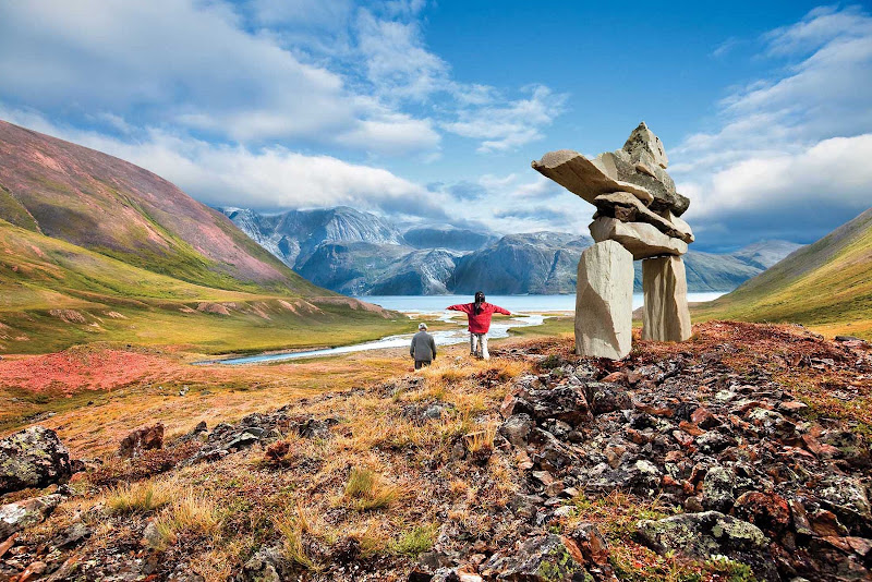 Inukshuk People with a rock edifice at Torngats Mountains in northern Newfoundland and Labrador.