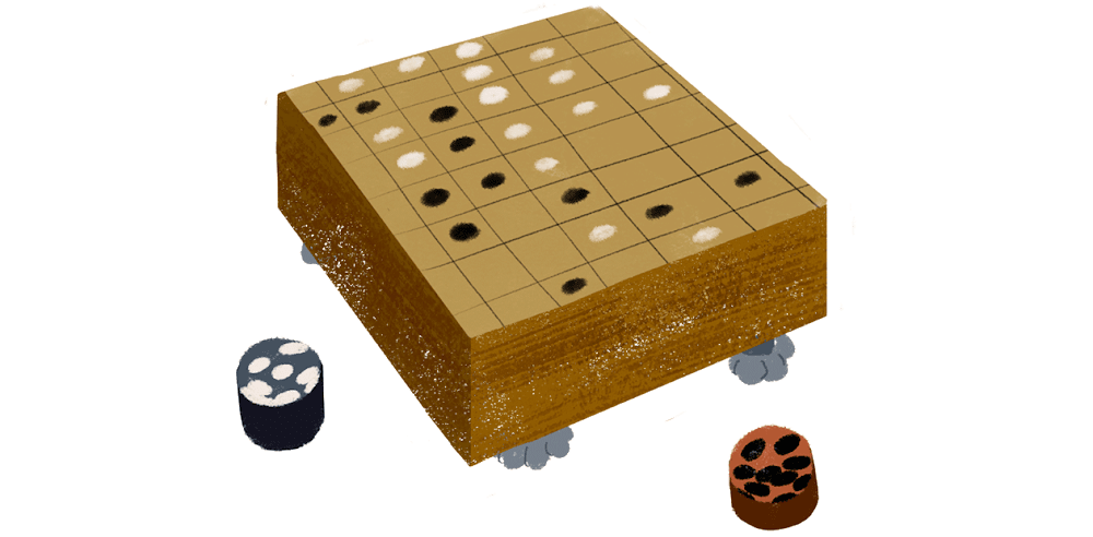 A board game is being played. It's a game of Go, thought by many to be the most complex board game in the world.