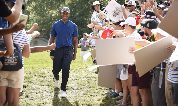 Tiger Woods walks to the 17th tee as fans cheer him on during a practice round of the PGA Championship golf tournament at Bellerive Country Club in St. Louis on Wednesday August 8, 2018.