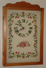 Photo: Kathryn did the needlepoint, from a Better Homes & Gardens pattern that was 95% of the work. I finished the frame, which came with the kit. The clock motor has been replaced once to radio controlled clock. Then back to a regular quartz. The cranberry motif is pretty unique. We did it together BC (before children) and still like it.