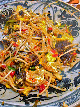 Photo: pan-fried mussel cakes with wilted bean sprouts and chilli sauce