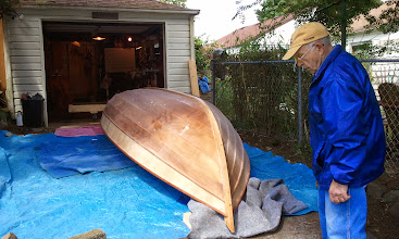 Photo: My neighbor Iain stopped by to supervise the flipping of the boat