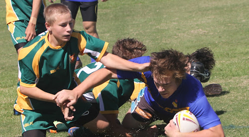 Narrabri High School's Damon Steel dives over for his second try of the match at Cooma Oval yesterday morning, easily shrugging off three Gunnedah defenders in the process.