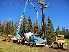 Photo: The concrete truck hooking up to the concrete pumping truck