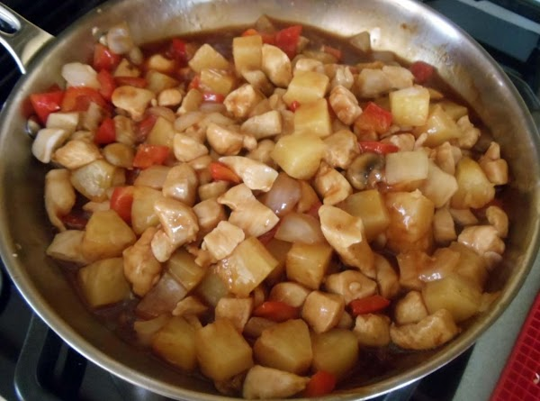 Add vegetables back to skillet along with sweet and sour sauce, soy sauce, pineapple...