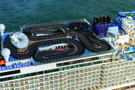 The top deck of Norwegian Encore shows the ship's Speedway, the longest race track at sea.