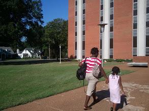 Photo: Brittani and Kaleya walk into the dorm