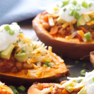Slow Cooker White Bean and Lentil Chili Stuffed Sweet Potatoes.