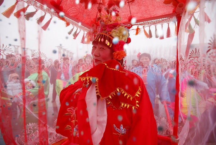 A performer dances during a folk art performance in Beijing.