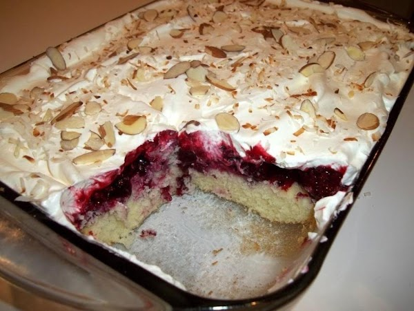 Spread atop the cooled berries and I sprinkled with sliced almonds and some toasted...