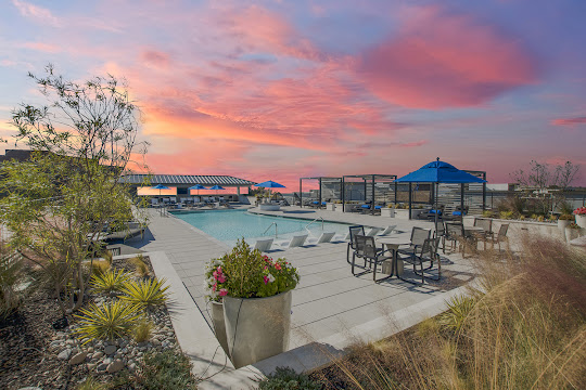 Upscale rooftop apartment swimming pool at dusk