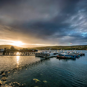 sunset over the harbor by Cristina Orlandini - Landscapes Cloud Formations ( clouds, europe, ireland, sunset, colors, boats, harbour, sea, ocean,  )