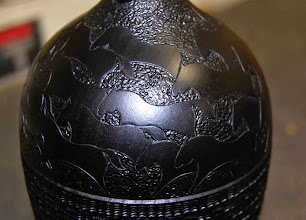 "Photo: Here's one variation of her signature horse pattern, with texturing, above her basket weave pattern, on a ""black-on-black"" hollow form.  This is the kind of work Molly will show us how to do."