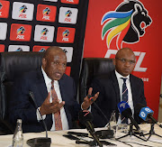 PSL Chairperson Dr Irvin Khoza and PSL media officer and Lux September during the National Soccer League Board of Governors Press Conference at Sandton Convention Centre on July 12, 2018 in Johannesburg, South Africa.