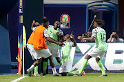 Nigeria's Odion Ighalo celebrates scoring their second goal with team mates.