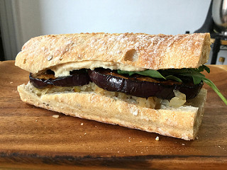 grilled onion and eggplant sandwich with hummus and arugula teaser.jpg