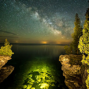 The Cliffs of Cave Point County Park in Door County, WI by Andy Taber - Landscapes Caves & Formations ( garyfonglandscapes, wisconsin, starry sky, door county, holiday photo contest, beach, space, photocontest, nightscape, milky way, lights, planets, lake michigan, sky, flashlight, stars, night, cave point state park, galaxy,  )