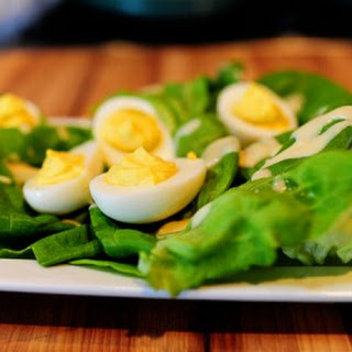Deviled Eggs on a Nest of Butter Lettuce with Honey Mustard Dressing.