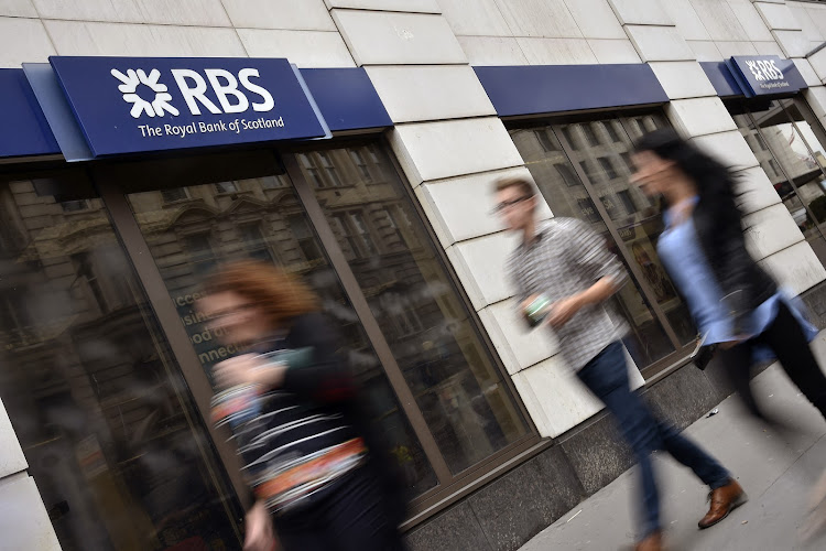 People walk past a branch of the Royal Bank of Scotland. Picture: REUTERS/TOBY MELVILLE