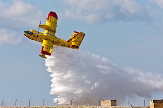 Photo: I thought I'd try an #ActionMonday image today.  This is (I think, please correct me if I'm wrong!) a Bombardier 415, an amphibious plane that is designed specifically for aerial fire-fighting. This was taken during an airshow in Malta, however I also saw one in action trying to put out a real bushfire in Mallorca a couple of months ago. I was very impressive to watch skimming the water, scooping up about 6000 litres of water over the course of about 400 metres. It then climbed steeply and dropped the load over the fire, banked sharply and repeated the manoeuvre many times. Each loop only took about 3-4 minutes and it was amazing to see how quickly it got the fire back under control.