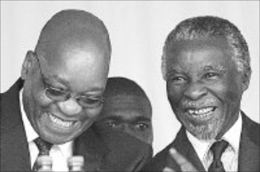 ANC BIGWIGS: Jacob Zuma and Thabo Mbeki at the reburial of Moses Mabhida. Pic.Unknown. 05/12/2006. © Unknown.