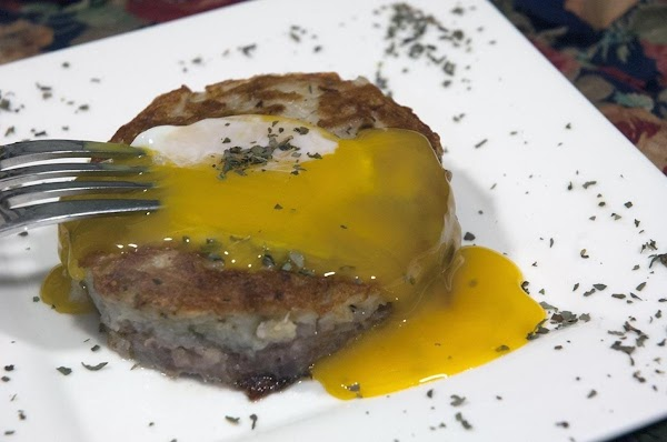 To eat, break the yolk over the hash browns, and let it seep into...