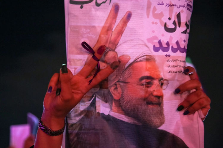 A supporter of Iranian President Hassan Rouhani holds his poster in Tehran, Iran. Picture: REUTERS