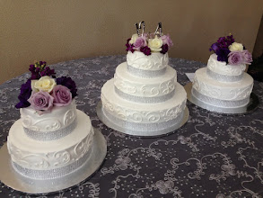 Photo: Fresh florals added to cakes as well as a topper on the main tier.