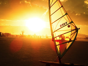 Photo: Windsurfing in the desert sun… another scene from the wide open playa at Burning Man….