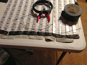 Photo: Aluminum bonsai wire is strong, but nice and malleable so it will flex along with body motion while still supporting the strips. Folded more tape over the wire onto the previous reinforcements, connecting them all together into a single band.