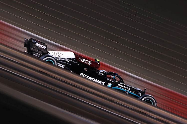 Valtteri Bottas of Finland driving the (77) Mercedes AMG Petronas F1 Team Mercedes W12 on track during the F1 Grand Prix of Bahrain at Bahrain International Circuit on March 28, 2021 in Bahrain, Bahrain.