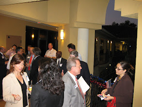 Photo: Mercantile Capital Corporation's guests networking after listening to the 3 candidates. www.504Blog.com