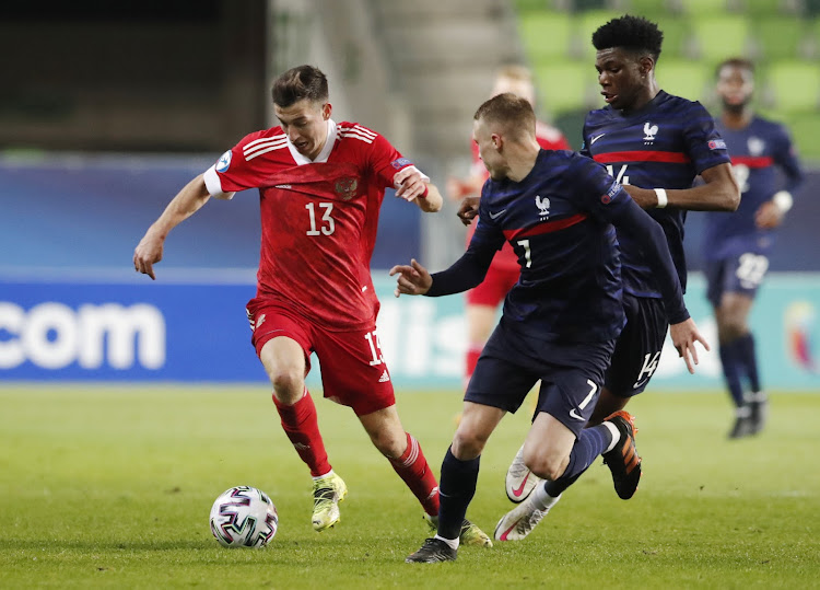 France's Adrien Truffert in action with Russia's Denis Makarov