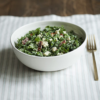 Kale Salad with Tofu Feta, Sun Dried Tomatoes, and Lemon Hemp Dressing