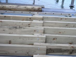 Photo: Detail of the new wooden joists and fixing bolts