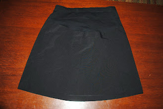Photo: Short Black Dressy Skirt by Motherhood Maternity size XL. No discolorations.... anything you see is from flash. Rayon/Polyester/Spandex with cotton belly panel and waistband. $2