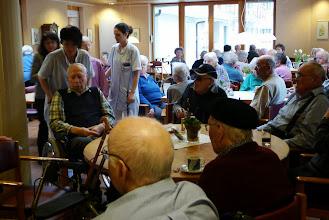 Photo: Ein voll besetzter Saal mit engagiertem Pflegepersonal.