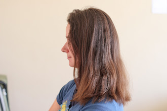 Photo: Spencer's first attempt at cutting Laura's hair.  After.