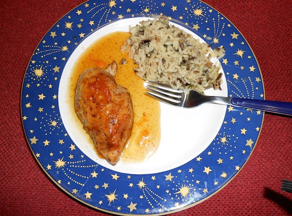 Spoon the sauce over the chicken and serve with the wild rice.