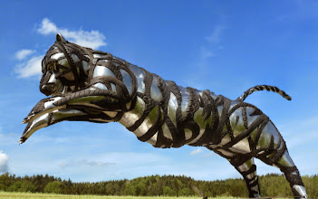 Photo: no comment any more, just enjoy, jumping Tiger Sculpture, used tires and scrap steel, www.mo-metallkunst.de
