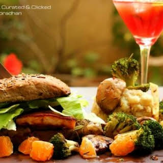 FISH BURGER SERVED WITH MASHES POTATOES AND VEGGIES.