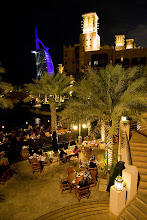Photo: Madinat Jumeirah resort place/shopping bazaar/thing, nice. Burj al Arab in evening lights in the background.
