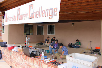 Photo: Dubotics (University of Washington) works on their tank-style rover in Hanksville during a quiet moment in the schedule.