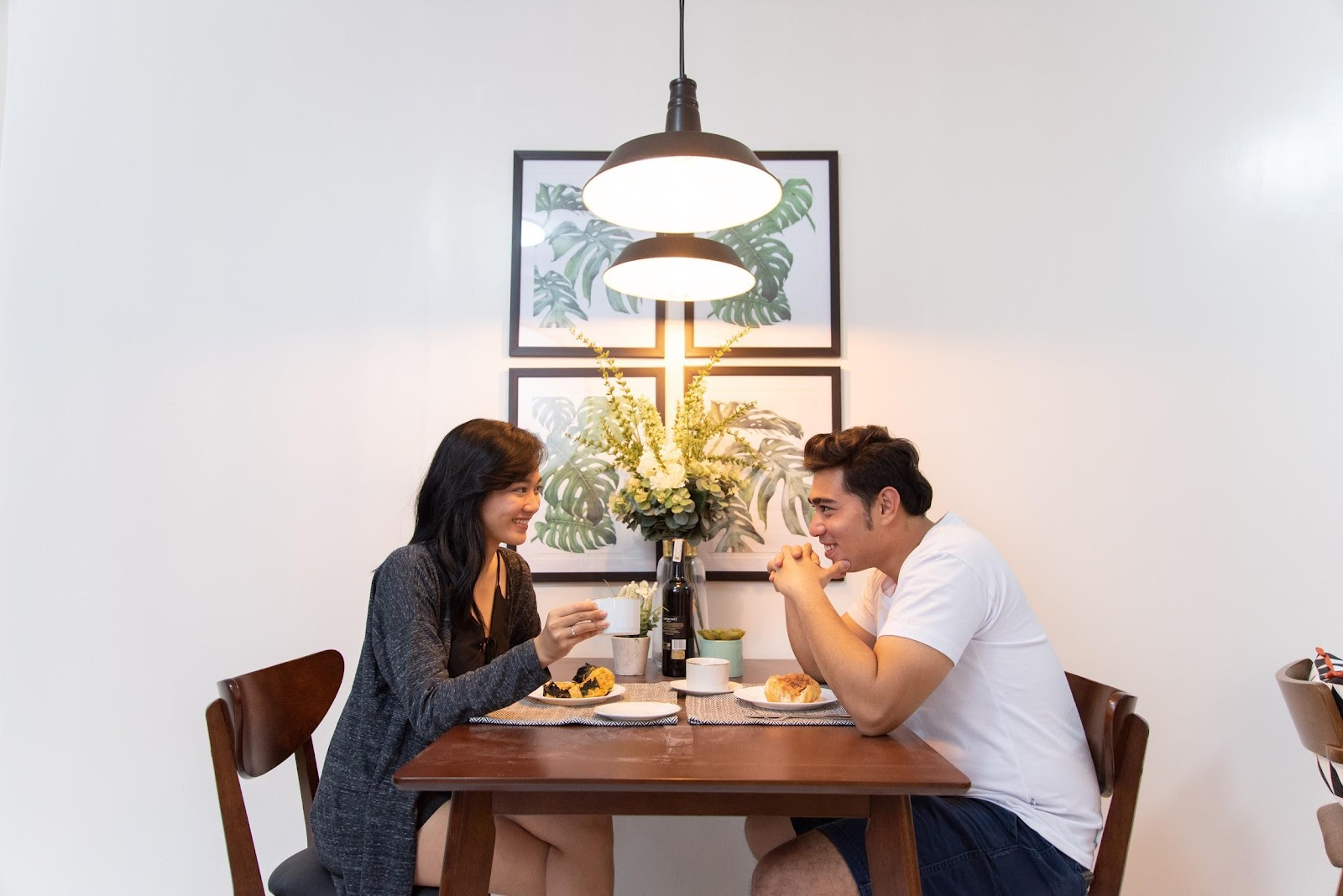 Woman and man having a meal together in their condo unit dining table in a condo for sale in Bacoor.
