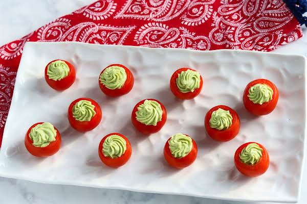 A Platter Of Avocado-stuffed Tomatoes.