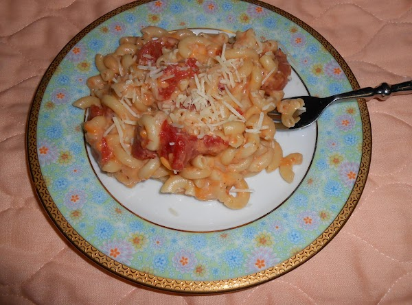Top with Parmesan cheese and serve with a green salad and garlic bread.