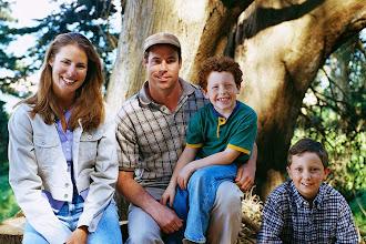 Photo: Family Sitting by Tree ca. 2000 San Francisco, California, USA