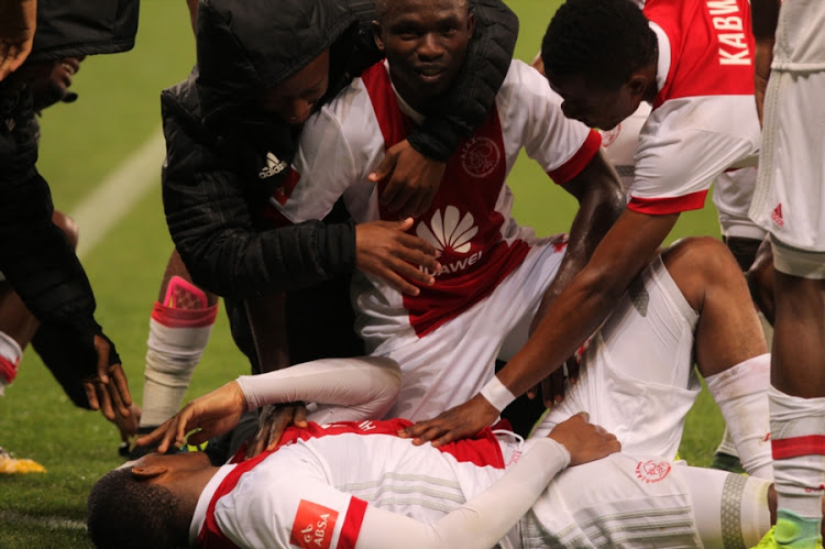 Prince Nxumalo of Ajax Cape Town celebrates with his teammates during the Absa Premiership match against Polokwane City at Cape Town Stadium on September 15, 2017 in Cape Town, South Africa.
