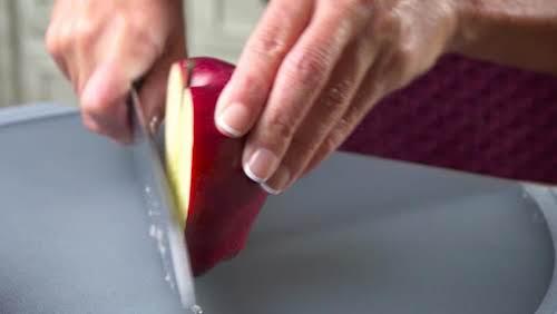 Step 1. Slice apple in half from stem to bottom.
