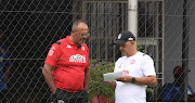 Highlands Park director Larry Brookestone (L) in a discussion with head coach Owen da Gama (R) at the club's training base in Johannesburg on March 11 2020.